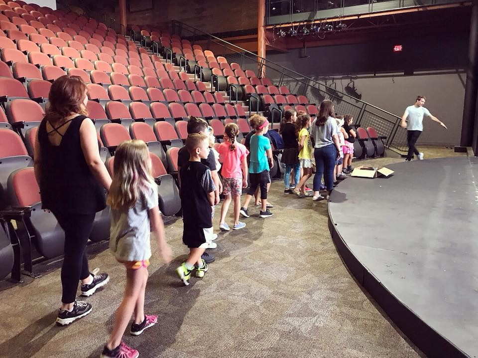 Children on a tour of a theater DOWNTOWN GLENS FALLS THEATER